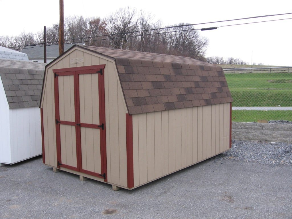 8x10 cheap utility shed - economy mini barn with duratemp walls, asphalt shingles and buckskin painted walls and red trim delivered to MD VA WV.
