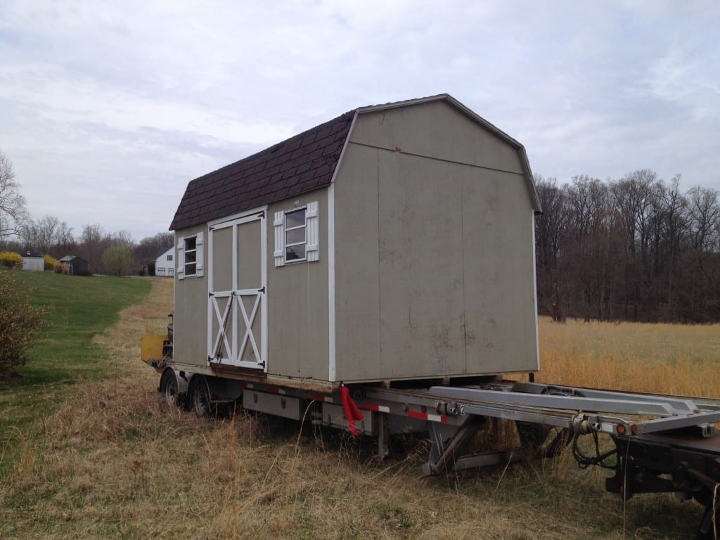 Old worn out storage shed was removed from home in Germantown md and replaced by new storage barn builder 4-outdoor. old storage barn in shown on trailer that 4-outdoor reviews every morning to ensure proper function