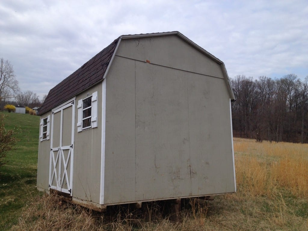 storage shed to be removed from property in Germantown Maryland by 4-Outdoor. This old storage barn with replaced with new barn for sale at 4-outdoor in Frederick MD